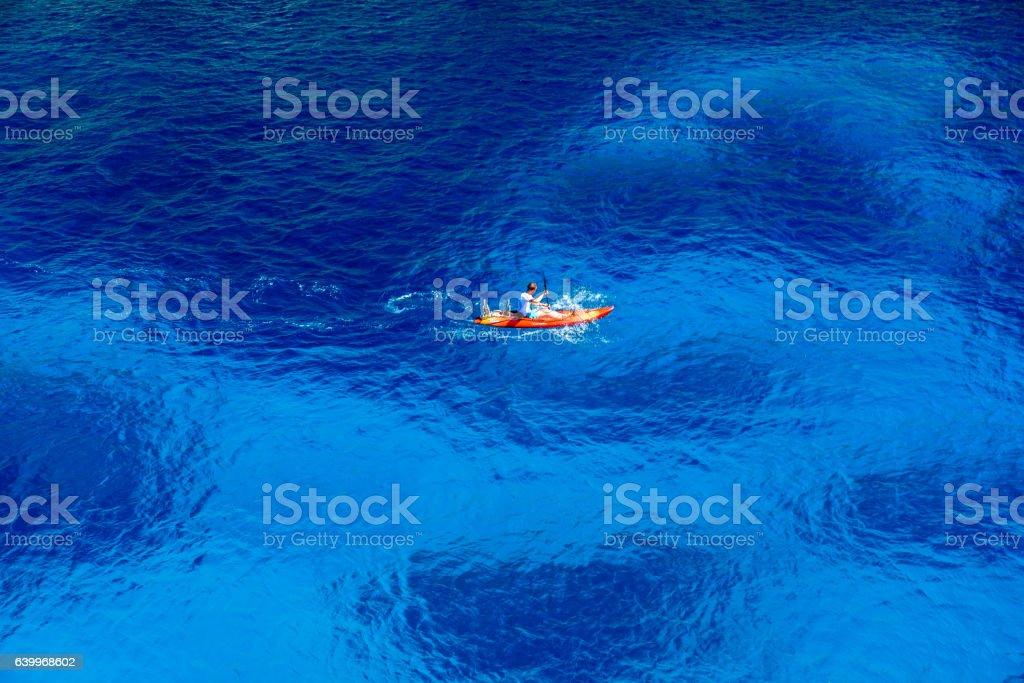 Kayaking in beautiful bay Cala Figuera stock photo