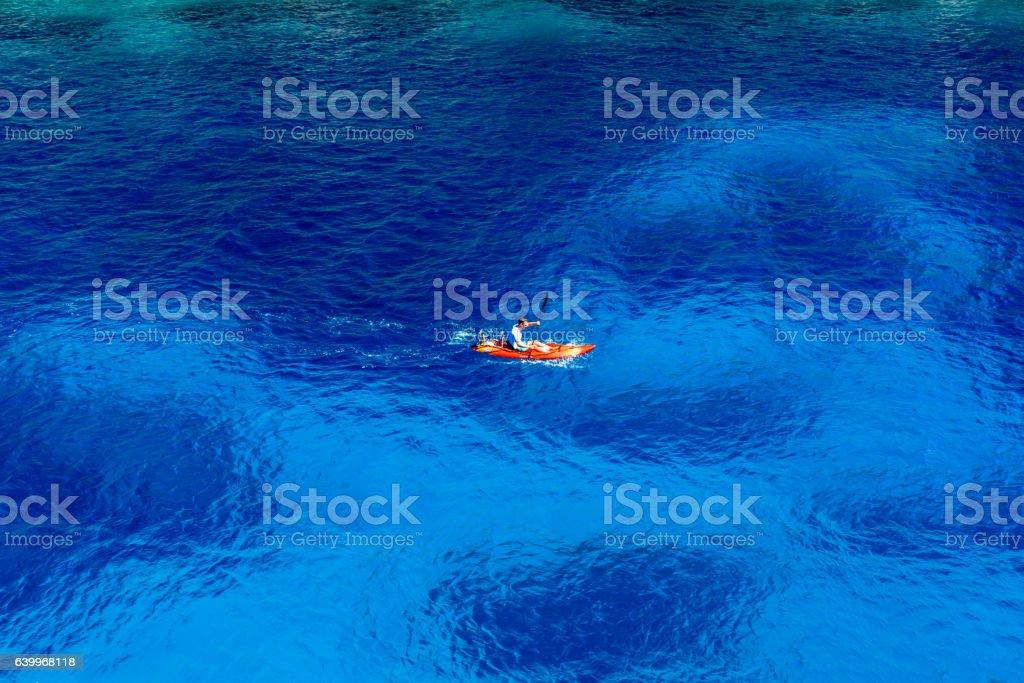 Kayaking in beautiful bay stock photo