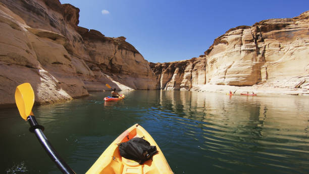 POV kayaking in canyons of Powell lake recreational area POV kayaking in canyons of Powell lake recreational area lake powell stock pictures, royalty-free photos & images