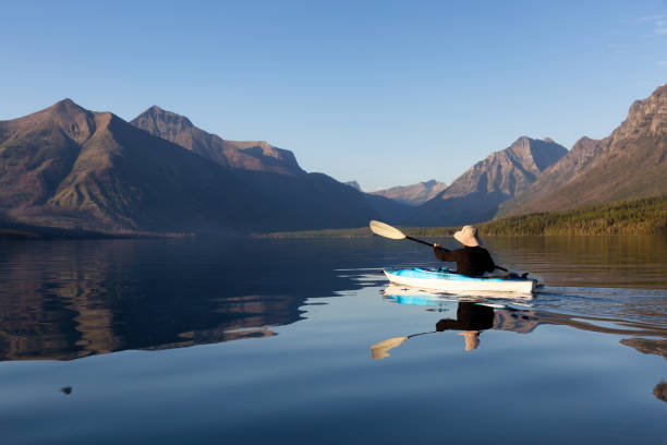 kayaking in glacier national park - mcdonald lake stock pictures, royalty-free photos & images