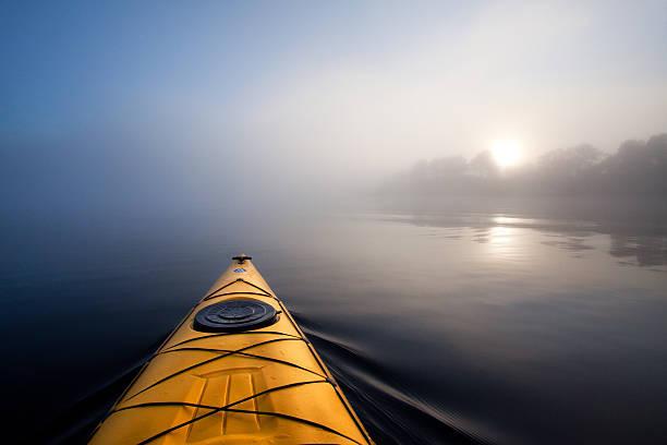 Kayaking in the fog. stock photo