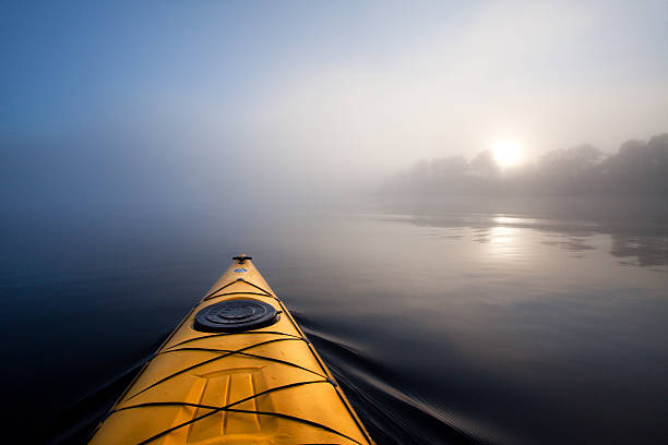 Kayaking in the fog. stock photo