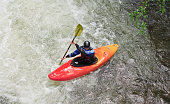 Great Smoky Mountains National Park, United States - May 10, 2008: A lone kayaker makes his way down the Little Pigeon River near the Chimneys in the Smoky Mountains. Heavy rainfall swells the river for a short time, so the kayakers move in quickly to ride the whitewater.
