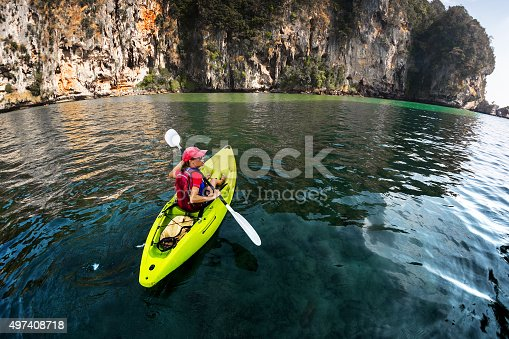 istock Kayaking near rocks 497408718