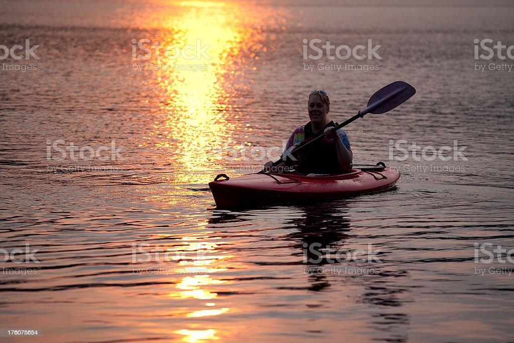 Kayaking on a quiet lake stock photo