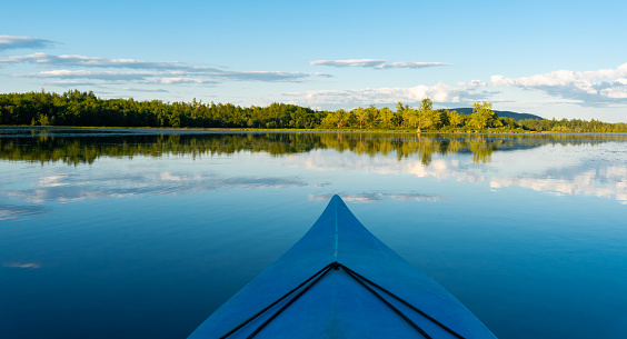 Kayaking on a beautiful summer day in a remote wilderness lake