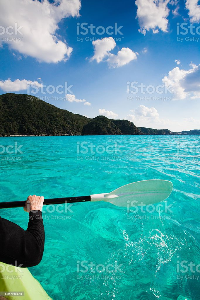 Kayaking on clear blue waters royalty-free stock photo