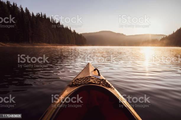 Photo of Kayaking on water in reflection lake in mountain.