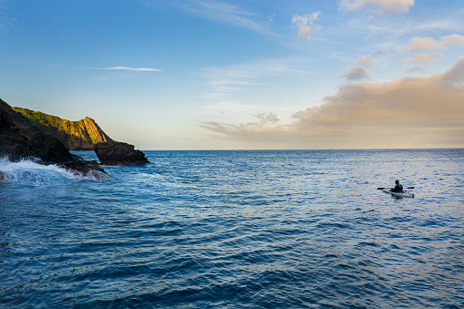 Caribbean coast seascape with man kayaking in the distance.