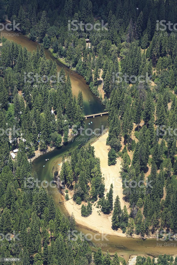 Kayaking river running through park in yosemite valley royalty-free stock photo