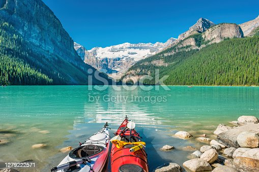 Kayaks at Lake Louise in Banff National Park, Alberta Canada on a sunny morning.
