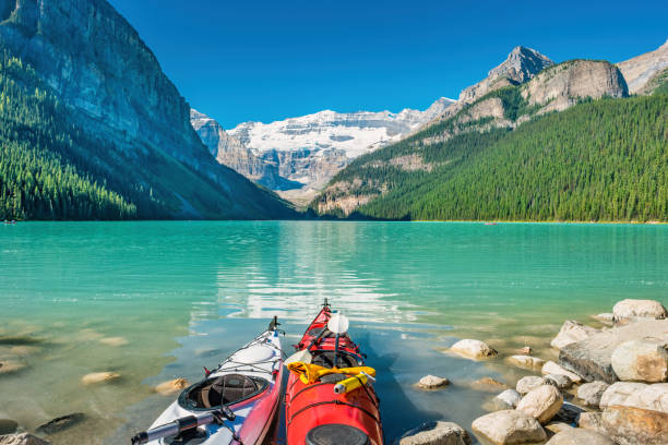 Kayaks at Lake Louise Banff National Park Alberta Canada stock photo