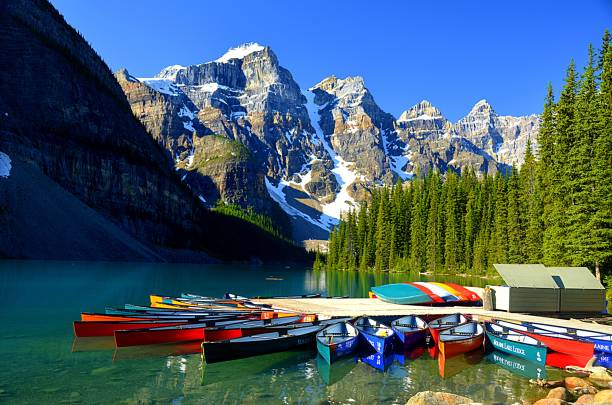 Kayaks at Moraine Lake Alberta Canada Rental kayaks in Moraine lake, Alberta with the Canadian Rocky mountains above. moraine lake stock pictures, royalty-free photos & images