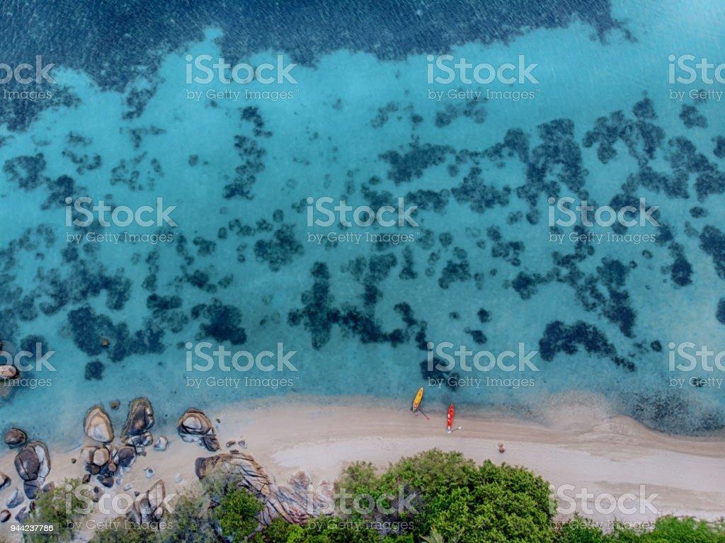 2 Kayaks at the wild beach stock photo