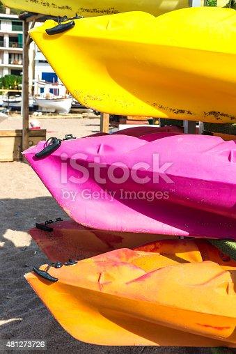 Colorful kayaks in stack in Costa Brava, Catalonia, Spain