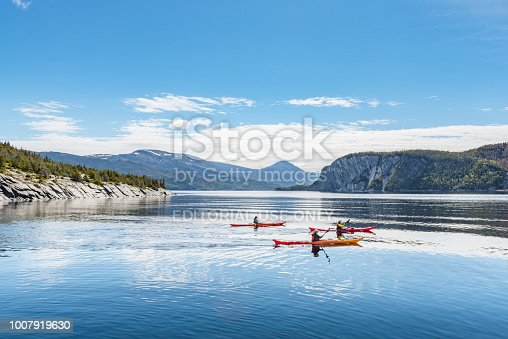 Newfoundland, Canada - June 12, 2018: Some travelers are playing kayaks in Norris Cove of Norris Point, NF Canada.