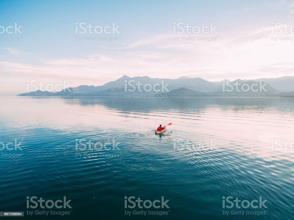 Kayaks in the lake. Tourists kayaking on the Bay of Kotor, near stock photo