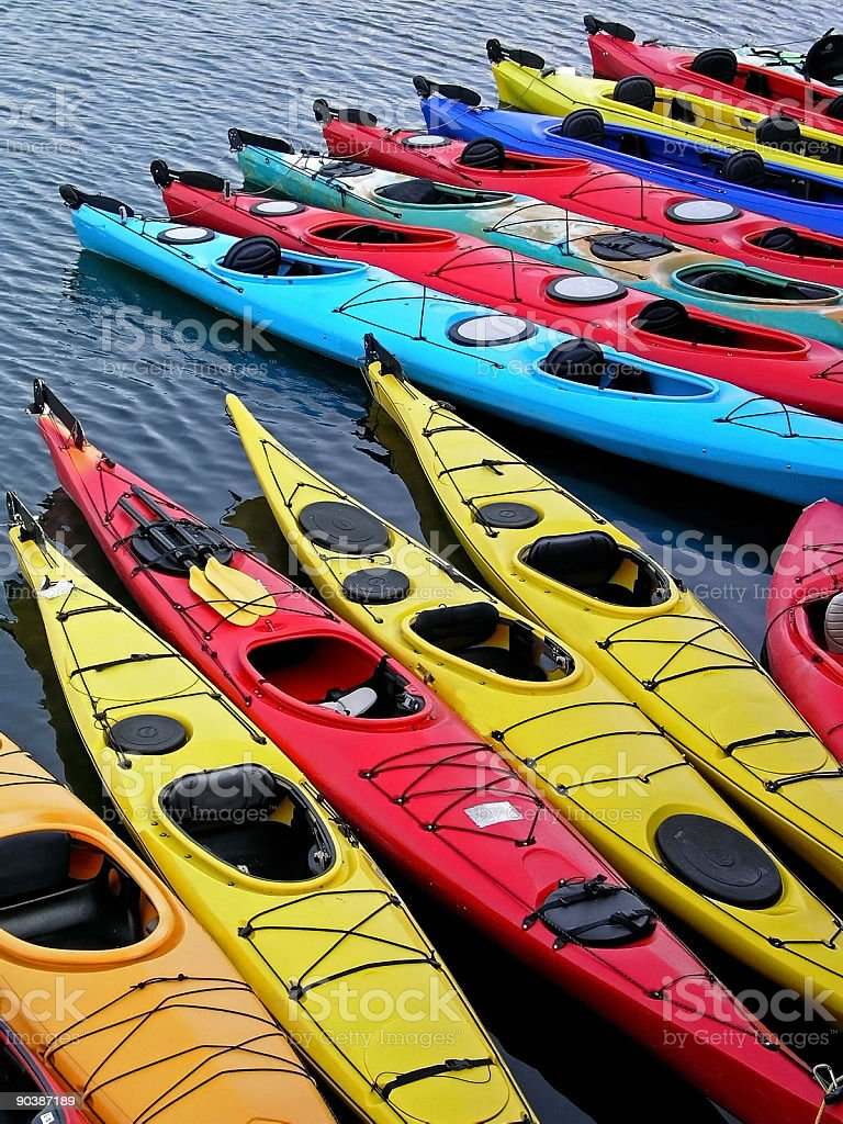 Kayaks lined up royalty-free stock photo