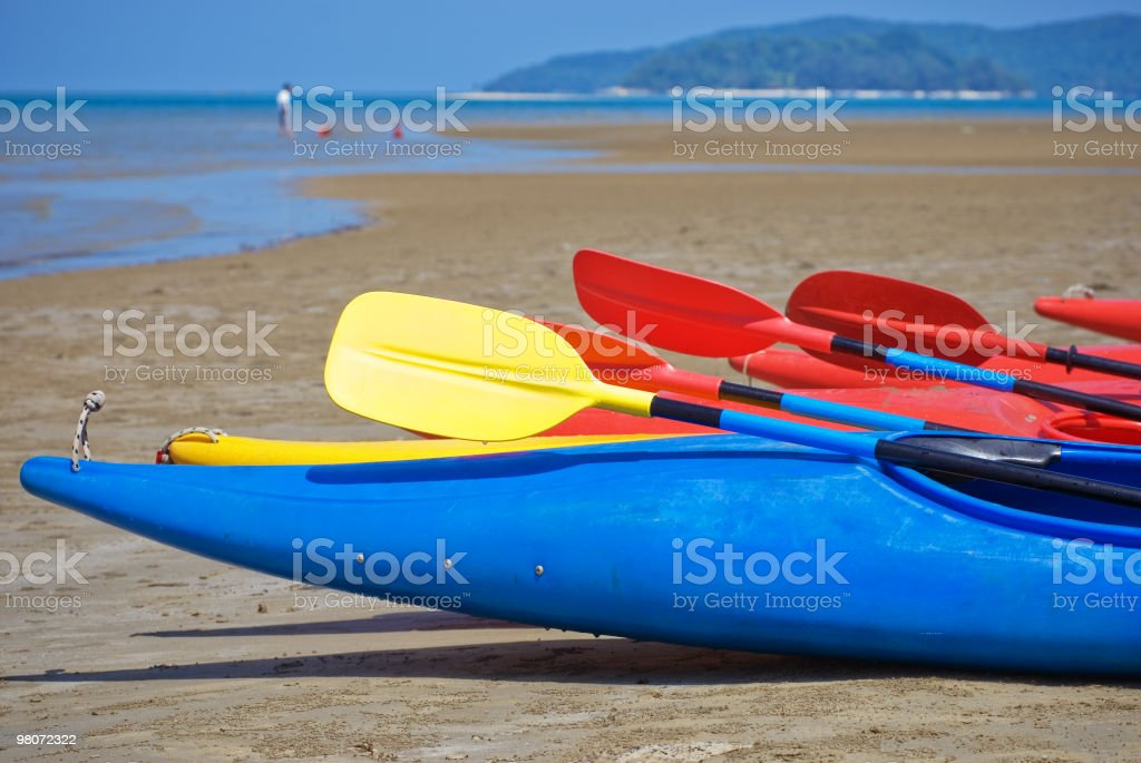 Kayaks on a tropical beach royalty-free stock photo