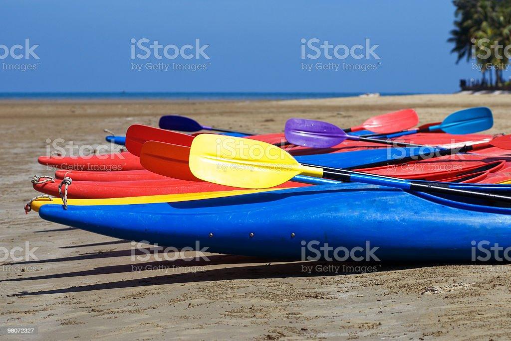 Kayaks on a tropical beach royalty-free stock photo