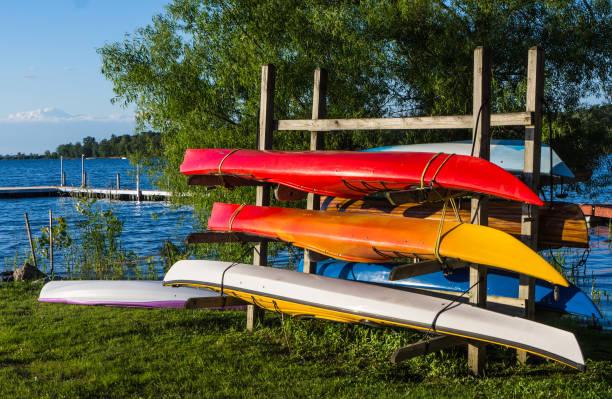 kayaks on lake shore stock photo