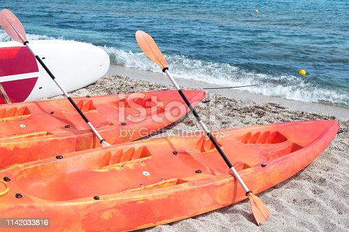 Kayaks outdoors on the beach by the sea -
