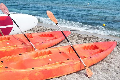 Kayaks on the beach by the sea