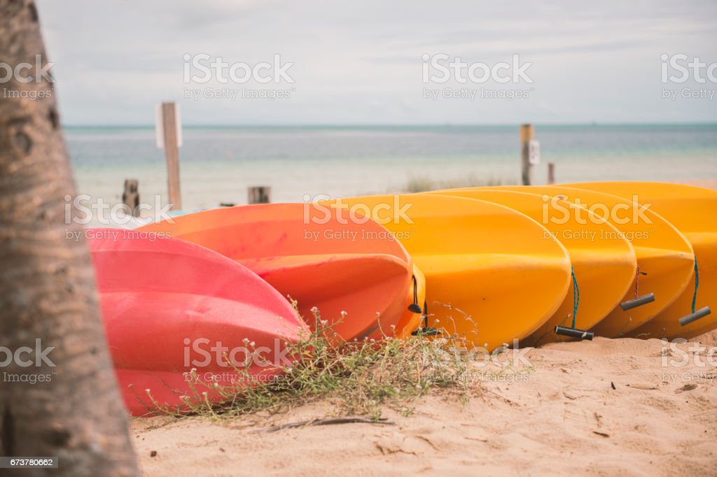 Kayaks on the beach during the day royalty-free stock photo