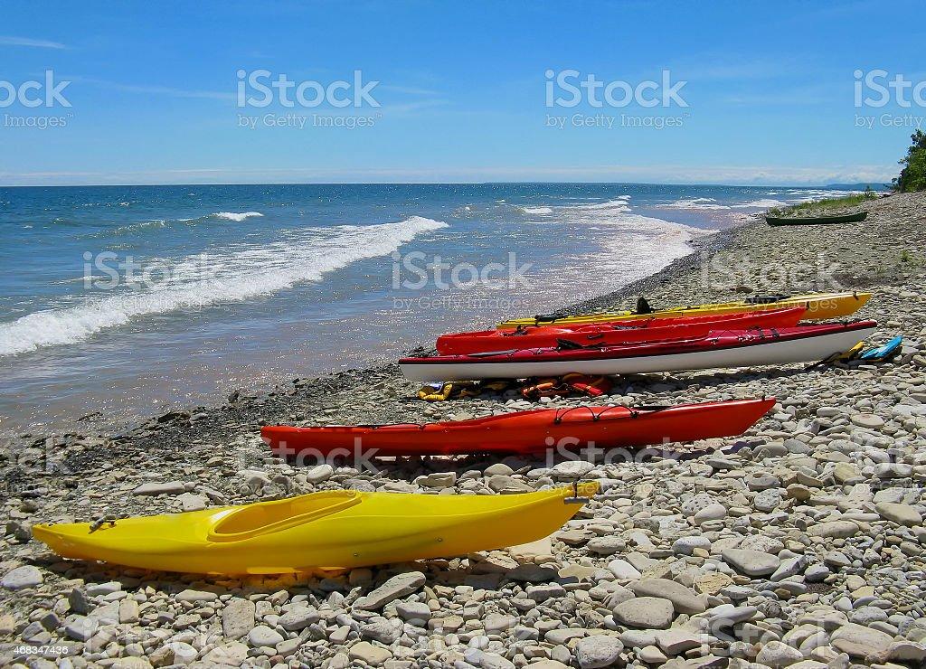 Kayaks on the beach stock photo