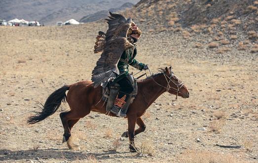 bayan Ulgii, Mongolia, 4th October 2015: kazakh eagle hunter in alandscape of western Mongolia