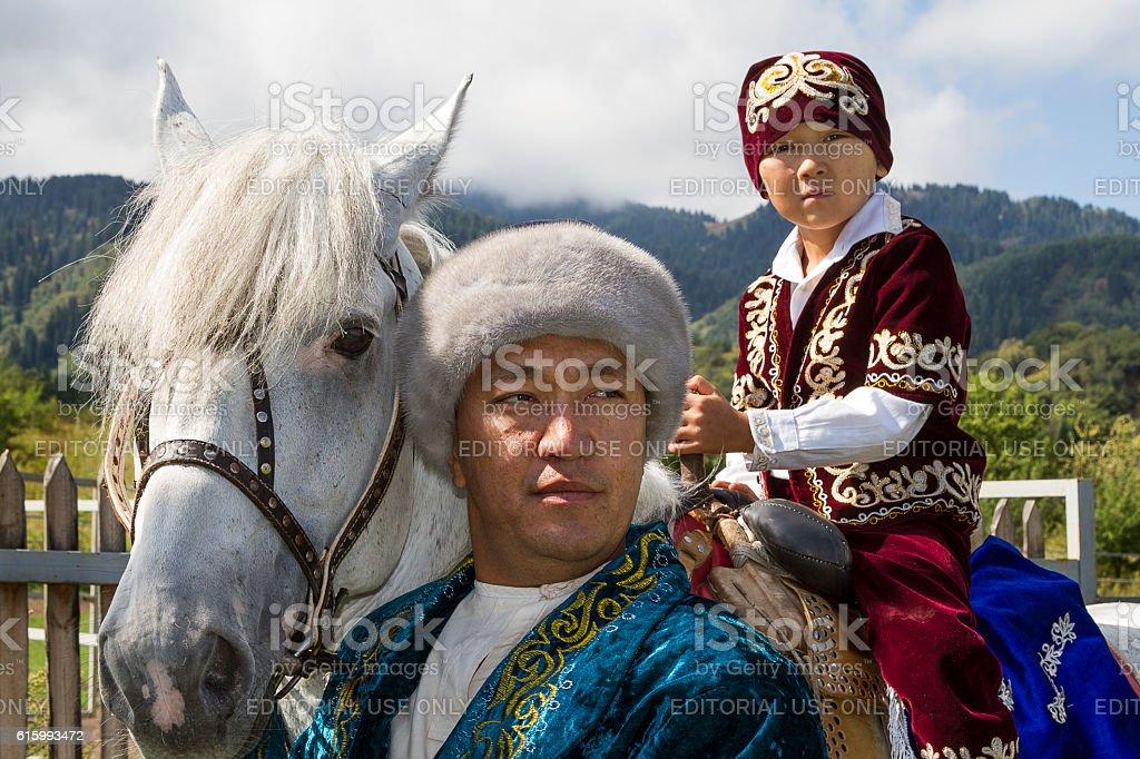 Kazakh father and son. stock photo