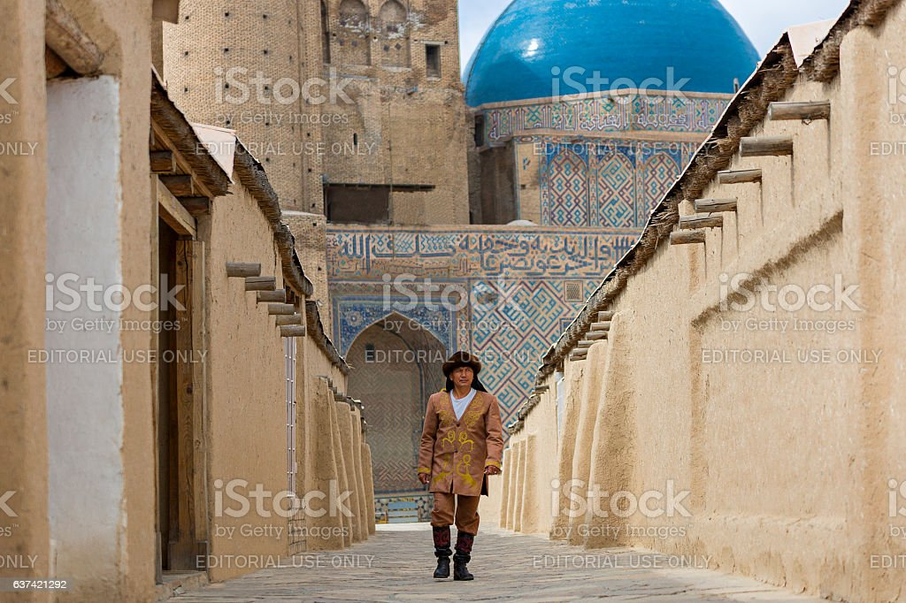 Kazakh man and Mausoleum of Khoja Ahmed Yasawi stock photo
