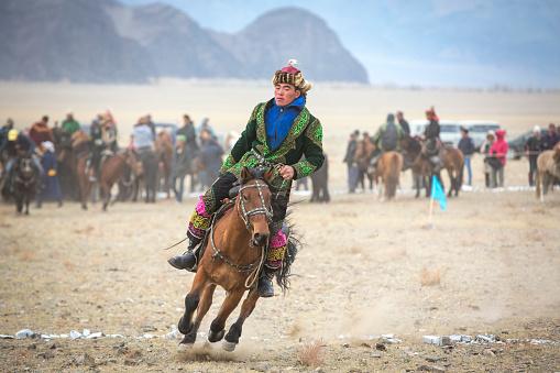 Bayan Ulgii, October 2015: kazakh man in traditional clothing, riding a horse