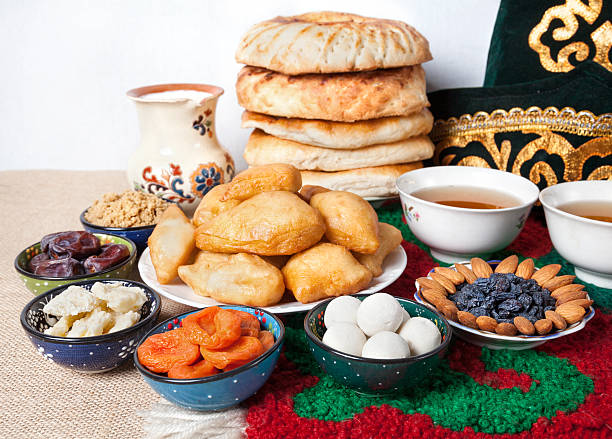 Kazakh national food Kazakh national food on the table with national hat and tea at white background muziekfestival stock pictures, royalty-free photos & images