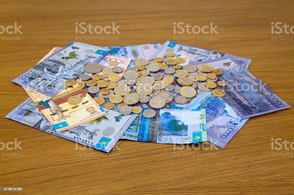 Kazakhstani tenge banknotes and coins stock photo
