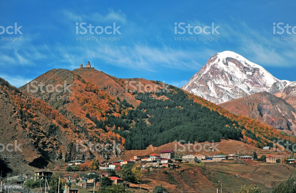Kazbegi village and Trinity church in mountains, Georgia stock photo