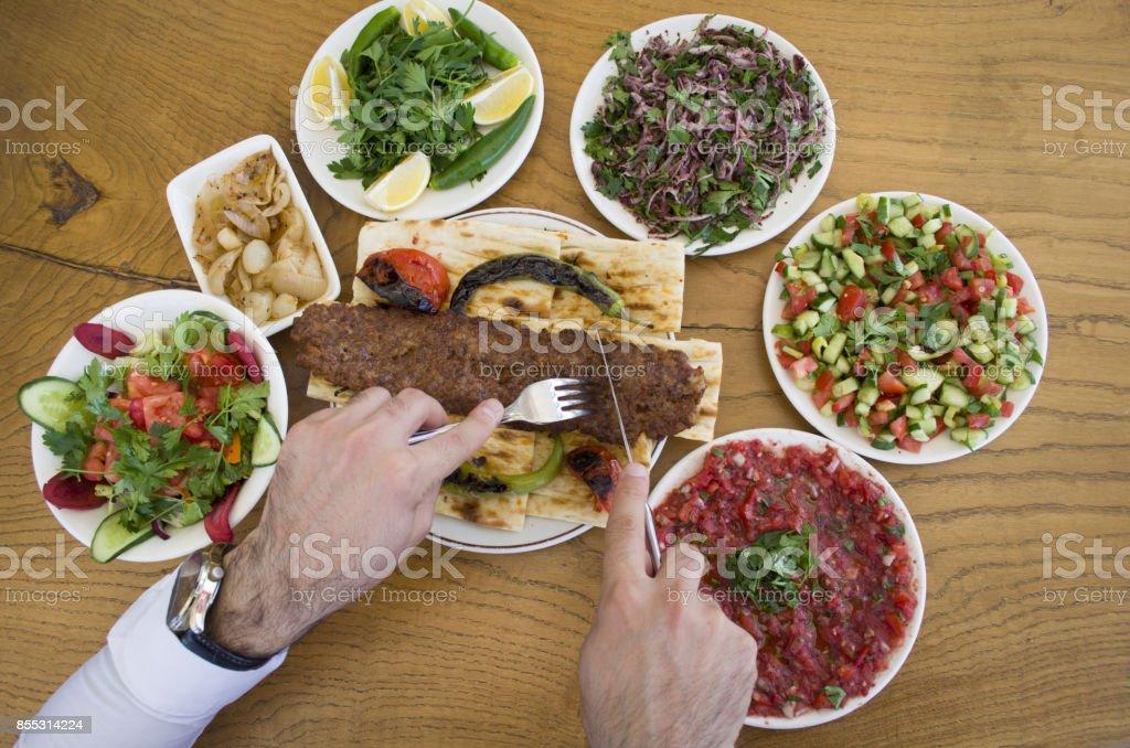 Kebab eating and adana kebab menu stock photo