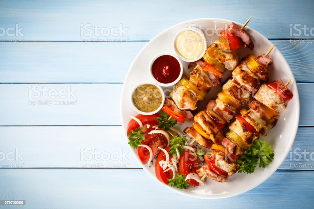 Kebab - grilled meat and vegetables stock photo