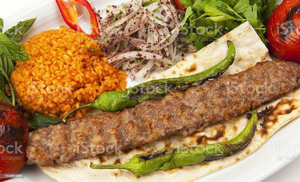 A kebab in a tortilla wrap and salad royalty-free stock photo