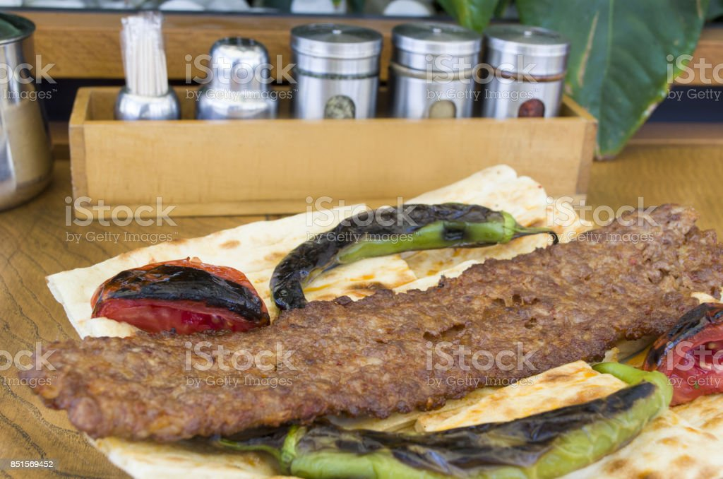kebab plate on wooden table stock photo