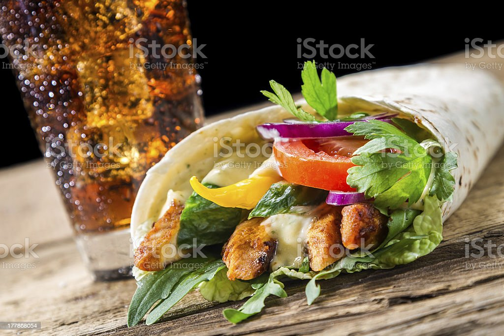 Kebab with fresh vegetables and chicken on black back royalty-free stock photo