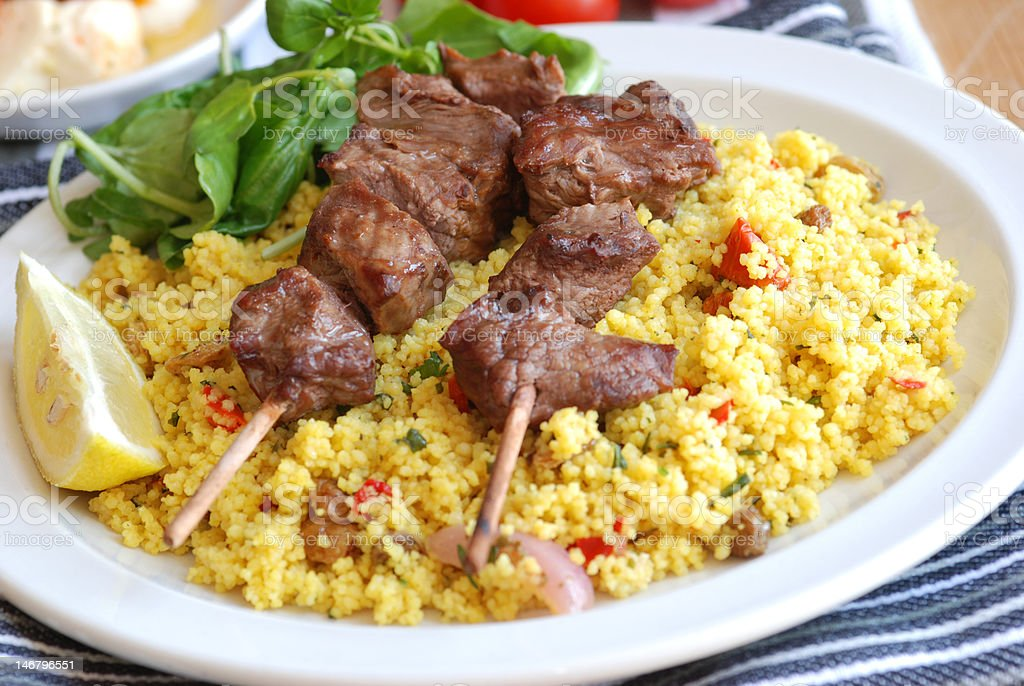 Kebabs with couscous stock photo