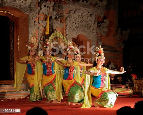 Ubud, Bali, Indonesia - August 10, 2011: Female dancers during a Kecak dance performance (based on the Ramayana) at Ubud Palace. Balinese dance is an important element of traditional culture, and dance dramas are presented to Western tourist audiences almost every night.