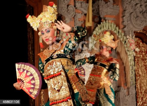 Ubud, Bali, Indonesia - August 10, 2011: Two female dancers during a Kecak dance performance at Ubud Palace. Balinese dance is an important element of traditional culture, and dance dramas are presented to Western tourist audiences almost every night.