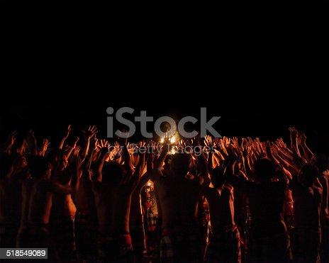 Men performing Balinese dance Kecak (Ramayana Monkey Chant) in a night. Indonesia