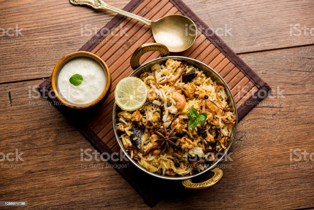 Keema or Kheema Biryani - Fragrant and spicy minced lamb or goat or chicken cooked in range of aromatic spices with basmati rice. served in a karahi with curd. selective focus stock photo