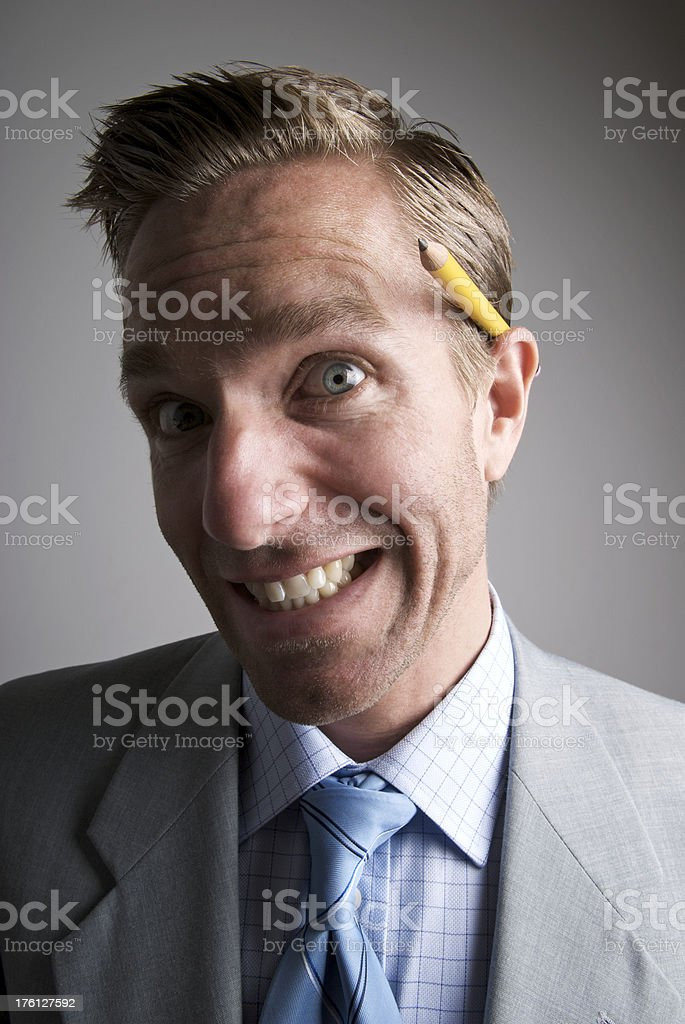 Keen Office Worker w Pencil Behind Ear stock photo