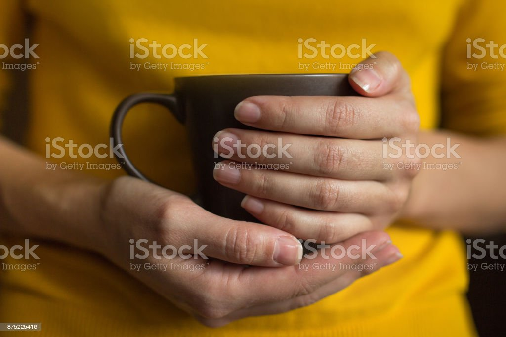 Keep a hot drink in your hands. Tea and coffee are good for health stock photo