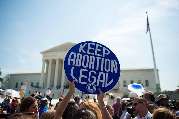 keep abortion legal sign at supreme court - abortion stock photos and pictures