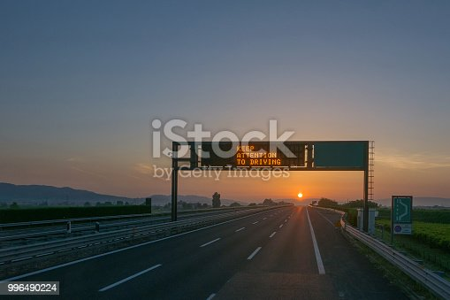 istock Keep attention to driving written on highway road sign 996490224